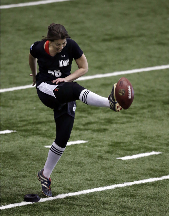 Lauren Silberman boots the ball during kicker tryouts at the NFL football regional combine workout Sunday, March 3, 2013, in Florham Park, N.J. (AP Photo/Mel Evans)