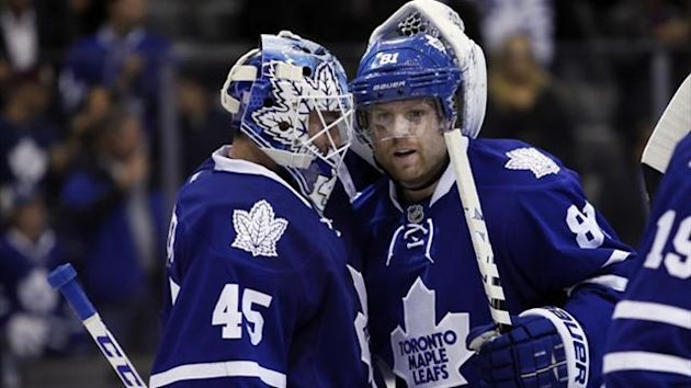 Toronto Maple Leafs goaltender Jonathan Bernier (45) and Toronto Maple Leafs forward Phil Kessel (81) congratulate each other (Reuters)