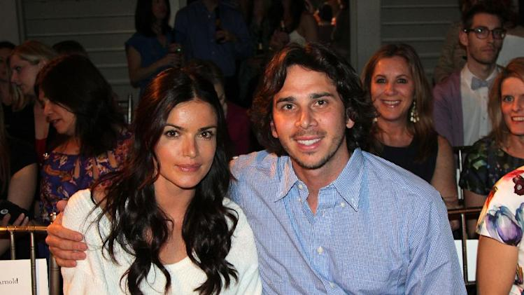 "Ben Flajnik, right, star of the ABC romance series ""The Bachelor,"" and his fiancee Courtney Robinson pose before the Mark Zunino for Kleinfeld wedding fashion show, Monday, April 16, 2012 in New York. (AP Photo/Nicole Evatt)"