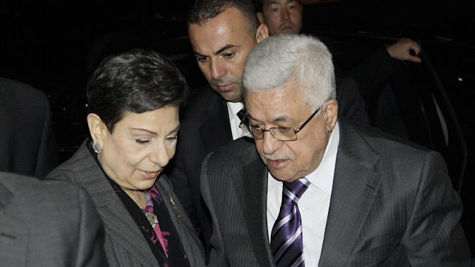 Palestinian President Mahmoud Abbas, right, is greeted by Hanan Ashrawi, left, legislator and activist, as he arrives at his hotel in New York, Monday, Sept. 19, 2011, to attend the 66th General Assembly session of United Nations, which begins Tuesday, Sept. 20. The United States and Europe scrambled Sunday, Sept. 18, for a strategy that would help avoid a showdown over whether to admit an independent Palestine as a new United Nations member. (AP Photo/David Karp)