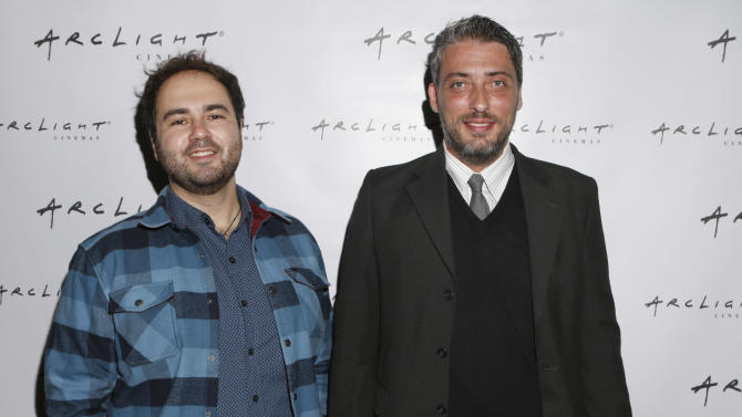 """Pavlos Georgiadis and Director Haris Donias from film """"Farming on Crisis?"""" attend Arclight Cinemas' 2nd Annual Documentary Film Festival Awards at the Arclight Hollywood on Saturday Nov. 10, 2012 in Hollywood, Calif. (Photo by Todd Williamson/Invision for Arclight Cinemas/AP Images)"""