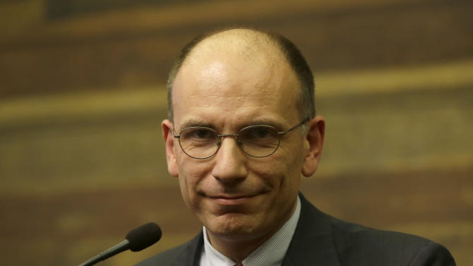 In this picture taken Thursday, April 25, 2013, Italian premier-designate Enrico Letta meets the journalists at the lower chamber in Rome, at the end of a day of meetings with of all of Parliament's forces, to secure as much support as possible to boost prospects of creating a government agenda that would balance measures for both austerity and growth. The center-left leader picked by Italy's president to form a coalition government worked doggedly Thursday to find common ground among bitterly opposed political blocs, which have been mired in deadlock for months. (AP Photo/Gregorio Borgia)
