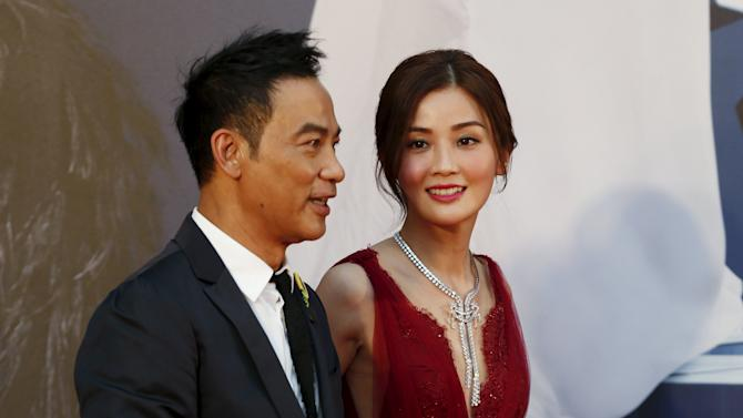 Hong Kong actor Simon Yam and actress Charlene Choi pose on the red carpet upon arrival at Hong Kong Film Awards