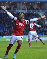 Arsenal's Theo Walcott celebrates scoring a goal during their English League Cup fourth round match against Reading at The Madejski Stadium in Reading. Arsenal won 7-5