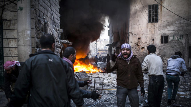 A man shout after a missile hits in a house in Aleppo, Syria, Thursday, Jan. 3, 2013. The fighting is part of the escalating violence in a Syrian civil war that the United Nations estimates has killed more than 60,000 people since the revolt against President Bashar Assad began in March 2011. (AP Photo/Andoni Lubaki)
