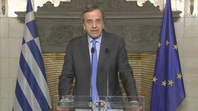 Greece's Prime Minister Samaras speaks during an unscheduled television address in Athens