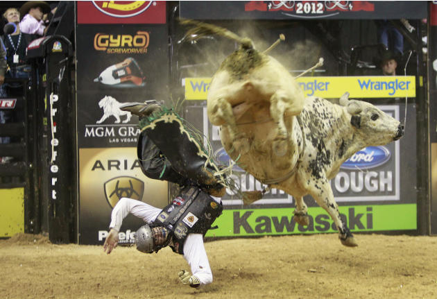 Hupp gets thrown off a bull during the Built Ford Tough Series Professional Bull Riders World Finals in Las Vegas