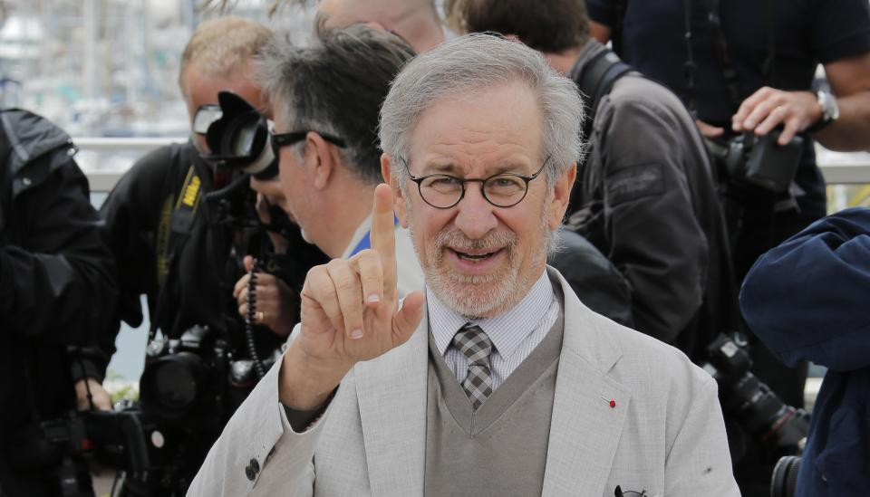 Jury president Steven Spielberg gestures during a photo call for the jury at the 66th international film festival, in Cannes, southern France, Wednesday, May 15, 2013. (AP Photo/Lionel Cironneau)