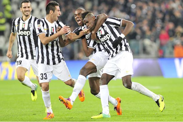 Juventus midfielder Paul Pogba, right, of France, celebrates with teammates Angelo Ogbonna and Mauricio Isla, of Chile, after scoring  during a Serie A soccer match between Juventus and Napoli at the