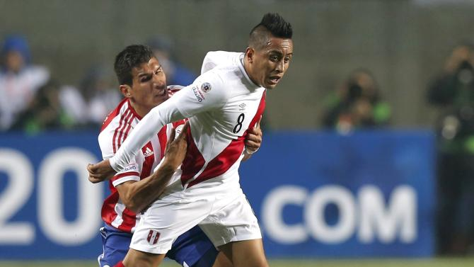 Peru's Cueva is tackled by Paraguay's Caceres during their Copa America 2015 third-place soccer match at Estadio Municipal Alcaldesa Ester Roa Rebolledo in Concepcion