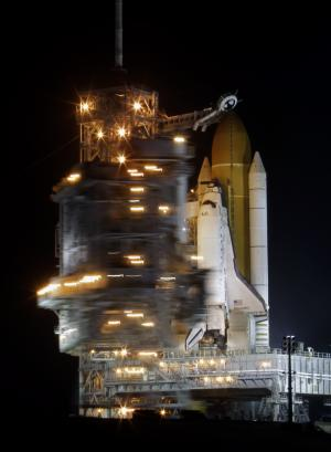 Space shuttle Discovery stands ready for launch at Pad 39A as the rotating service structure is moved back to expose the orbiter at the Kennedy Space Center in Cape Canaveral, Fla., Wednesday, Feb. 23, 2011. (AP Photo/John Raoux)
