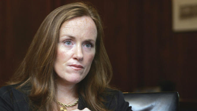 FILE- In this Sept. 14, 2006 file photo, Nassau County District Attorney Kathleen Rice listens to a reporter's questions in her Mineola, N.Y. office. Rice barred her prosecutors from keeping handguns, even at home; her office said the goal was safety. Although her successor, current acting Nassau County District Attorney Madeline Singas loosened the policy, prosecutors are still prohibited from carrying guns at work. (AP Photo/Ed Betz, File)