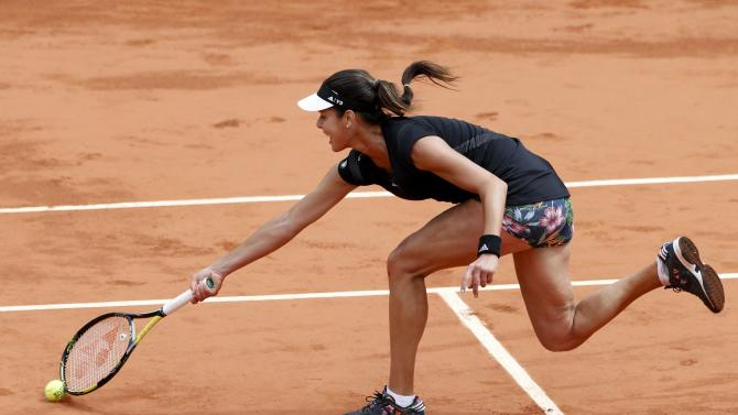 Ana Ivanovic of Serbia returns the ball to Elina Svitolina of Ukraine during their women's quarter-final match during the French Open tennis tournament at the Roland Garros stadium in Paris