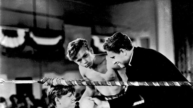 """FILE - This file image shows Mickey Rooney, left, Spencer Tracy, right, and Frankie Thomas in a scene from the 1938 film """"Boys Town."""" Rooney, a Hollywood legend whose career spanned more than 80 years, died Sunday, April 6, 2014, at his North Hollywood, Calif. home. He was 93. (AP Photo/File)"""
