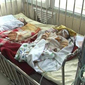 Four to a bed at strained Afghan children's hospital