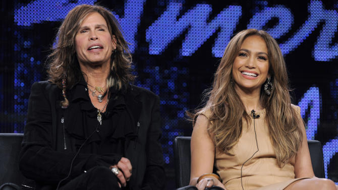 """FILE - In this Jan. 11, 2011 file photo, Steven Tyler, left, and Jennifer Lopez, judges on the FOX series """"American Idol,"""" take part in a panel discussion during the FOX Broadcasting Company Television Critics Association winter media tour in Pasadena, Calif. Randy Jackson, Paula Abdul and Simon Cowell were the original judges on """"American Idol."""" The cast of judges has changed over the years, with Jackson now the lone judge left from the first season. On Sunday, Sept. 16, 2012, singer-rapper Nicki Minaj and country crooner Keith Urban were named as judges, joining Mariah Carey and Jackson, as the judges' panel has now expanded to four members from its previous three. (AP Photo/Chris Pizzello, File)"""