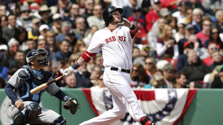 Boston Red Sox's Jarrod Saltalamacchia watches his solo home run with Tampa Bay Rays catcher Jose Lobaton during the fifth inning of a baseball game at Fenway Park in Boston Monday, April 15, 2013. (AP Photo/Winslow Townson)