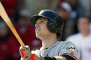 San Francisco Giants&#039; Buster Posey Hits A Grand Slam Off Cincinnati Reds Starting Pitcher Mat Latos In The Fifth Inning Of Game 5 Of The National League Division Baseball Series, Thursday, Oct. 11, 2012, In Cincinnati. (AP Photo/David Kohl)