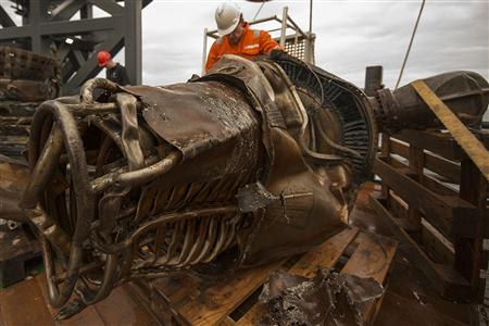 A heat exchanger from an Apollo F-1 engine is seen in this handout photo from Bezos Expeditions taken onboard a recovery ship off the coast of Florida March 19, 2013. REUTERS/Bezos Expeditions/Handout