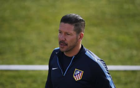 Atletico Madrid's coach Simeone attends a training session at the club's sports grounds in Majadahonda