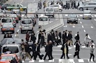 This file photo shows pedestians crossing a street in downtown Tokyo, in 2011. Japanese manufacturers are increasingly nervous, a major business survey showed on Monday, as sagging demand at home and abroad is compounded by fears over the effects of a nasty territorial spat with China