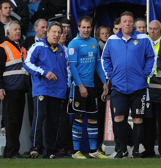 Neil Warnock, left, denies an FA charge of improper conduct