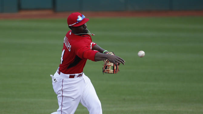 Cincinnati Reds' Brandon Phillips throws the ball during the third inning of a spring training exhibition baseball game against the Cleveland Indians, Tuesday, March 3, 2015, in Goodyear, Ariz. (AP Photo/John Locher)