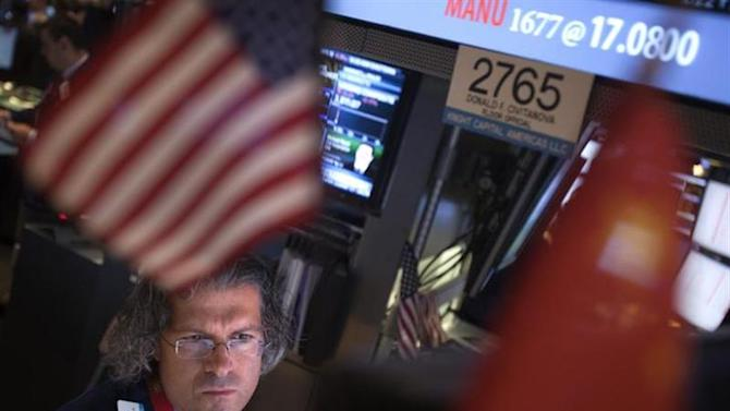 A trader looks at his screen on the floor of the New York Stock Exchange at the market open in New York, October 15, 2013. REUTERS/Carlo Allegri