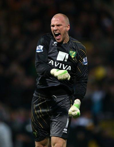 Norwich keeper John Ruddy, pictured, celebrates after Grant Holt scored
