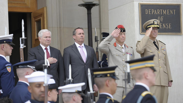 Defense Secretary Robert Gates, left, is joined by, from second from left, British Defense Minister Liam Fox, Chief of Defense Staff Gen. David Richards and Joint Chiefs Chairman Adm. Michael Mullen, during the playing of the National Anthem at an honor cordon ceremony at the Pentagon, Tuesday, April 26, 2011. (AP Photo/Susan Walsh)