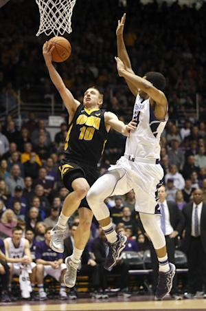 No. 10 Iowa beats Northwestern 76-50