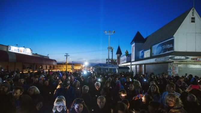 """Residents of New Jersey take part in a """"Light The Shore"""" event on the one year anniversary of the landfall of Hurricane Sandy in Seaside Heights, New Jersey"""