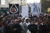 "Protesters hold placards depicting Egypt's ousted President Hosni Mubarak, one encircled in a noose that reads, in Arabic, ""rule of the people,"" left, and another depicting a statue of Mubarak being glued back onto a pedestal with writing that reads, ""fall, fall, to the military rule,"" at a rally honoring those killed in clashes with security forces in Tahrir Square in Cairo, Egypt, Friday, Jan. 20, 2012, nearly a year after the 18-day uprising that ousted Mubarak. Activists are now trying to energize the public to demand that the ruling military step down. (AP Photo/Khalil Hamra)"