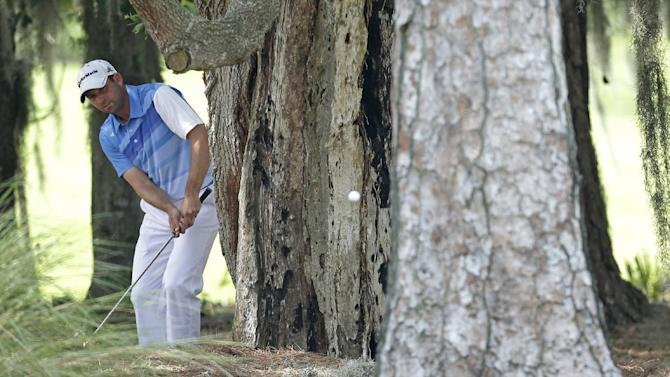 Sergio Garcia, of Spain, hits from the trees in the rough of the second hole during the third round of The Players championship golf tournament at TPC Sawgrass, Saturday, May 11, 2013, in Ponte Vedra Beach, Fla. (AP Photo/Chris O'Meara)