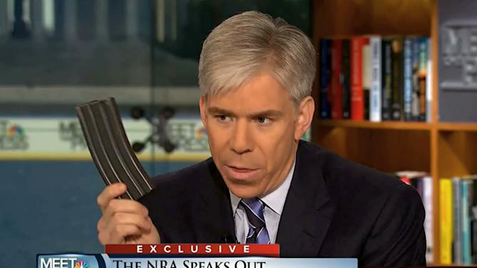 """This video frame grab image provided by""""Meet the Press"""" shows host David Gregory holding what he described as a high-capacity ammunition magazine during a recent Sunday's program.  Gregory won't face charges for displaying what he said was a high-capacity ammunition magazine on his """"Meet the Press"""" show. D.C. prosecutors announced the decision Friday, saying criminal charges wouldn't serve the public's best interests.  (AP Photo/Meet the Press)"""