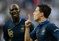 France midfielder Samir Nasri (right) with teammate Alou Diarra after scoring a goal during the Euro 2012 championships match against England in Donetsk, Ukraine, on June 11. L'Equipe newspapers has reported there were angry exchanges between Diarra and Nasri after France's 2-0 loss to Sweden on Tuesday in Kiev