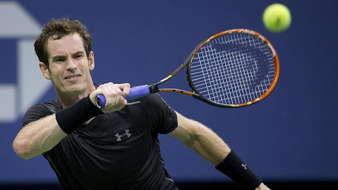 Andy Murray of Britain hits the ball to Nick Kyrgios of Australia during their first round match at the U.S. Open Championships tennis tournament in New York