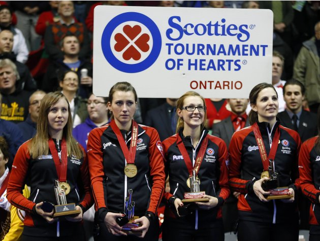 Ontario skip Homan, Miskew,  Kreviazuk, and Weagle stand with their medals after defeating Manitoba to win their gold medal game at the Scotties Tournament of Hearts curling championship in Kingston