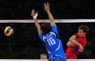 Italy's Vigor Bovolenta (left) attempts to block a Russian spike during the men's volleyball bronze medal match in the 2008 Beijing Olympic Games in Beijing on August 24, 2008. Two Italian doctors are facing manslaughter charges the volleyball player's death, ANSA news agency reported