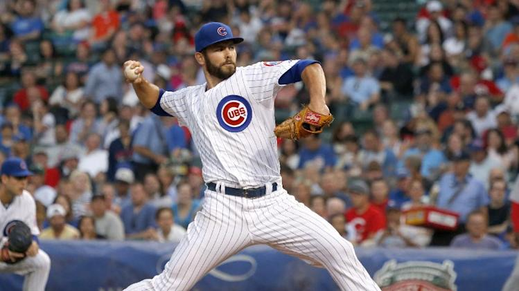 Arrieta leads Cubs past Reds 7-3