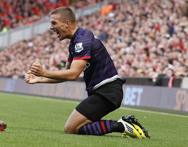 Lukas Podolski celebrates his goal at Anfield