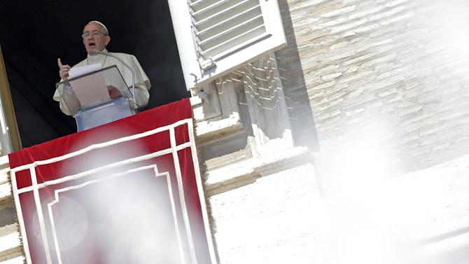 Pope Francis talks from the window during his Sunday Angelus prayer in Saint Peter's square at the Vatican