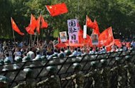 Chinese activists shout anti-Japan slogans during a protest rally in Beijing on September 18. Chinese ships have plied the waters of a disputed island chain, Japan&#39;s coastguard said, as a fleet of Taiwanese fishing boats set sail for the area, vowing to stake Taipei&#39;s claim