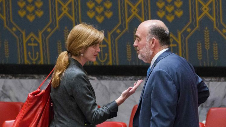 U.S. Ambassador to the U.N. Samantha Power speaks with Israel's U.N. Ambassador Ron Prosor, before a meeting of the Security Council at the headquarters in New York