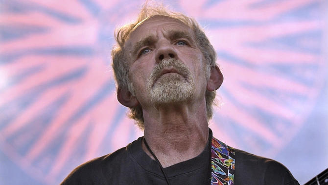 "FILE - In this June 5, 2004 file photo, singer-songwriter J.J. Cale plays during the Eric Clapton Crossroads Guitar Festival in Dallas, Texas. Cale, whose best-known songs became hits for Eric Clapton with ""After Midnight"" and Lynyrd Skynyrd with ""Call Me the Breeze,"" has died. He was 74. Caleís manager Mike Kappus said the architect of the Tulsa Sound died Friday, July 26, 2013 of a heart attack at Scripps Hospital in La Jolla, Calif. (AP Photo/Tony Gutierrez, File)"