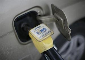 E85 Ethanol biodiesel fuel is shown being pumped into a vehicle at a gas station in Nevada, Iowa
