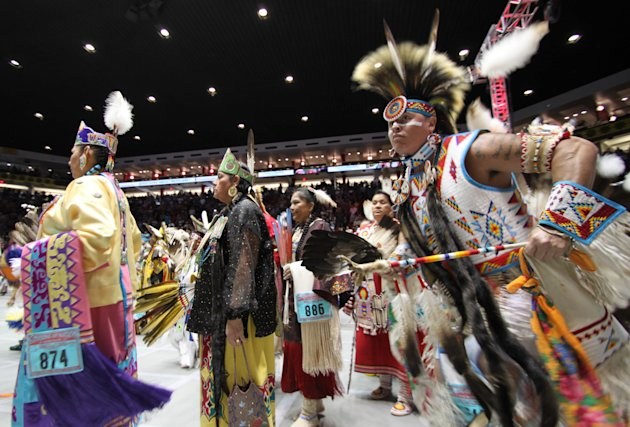 Hundreds of Native American and indigenous dancers pour onto the floor at University of New Mexico Arena for the grand entry during the 29th Annual Gathering of Nations in Albuquerque, N.M., on Friday