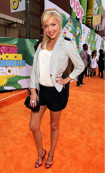 "Arielle Kebbel of The CW's ""Life Unexpected"" makes a grand entrance on the Kids' Choice Awards orange carpet. Nickelodeon's 24th Annual Kids' Choice Awards"