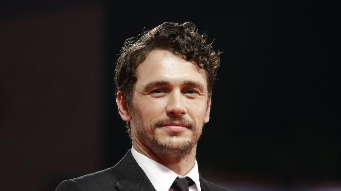 """FILE - This Sept. 5, 2012 file photo shows actor James Franco at the premiere of the film """"Spring Breakers"""" at the 69th edition of the Venice Film Festival in Venice, Italy.  Franco has directed a short film anchoring a social media campaign for shoe designer Stuart Weitzman. Four vignettes, which will debut on the brand's Facebook page, follow model Petra Nemcova as she takes what the company describes as """"a midnight fantasy stroll."""" The inspiration came from the 1988 underground club-scene movie """"Mondo New York,"""" and Nemcova struts to an updated version of the Patsy Cline song, """"Walking After Midnight.""""(AP Photo/Andrew Medichini, file)"""