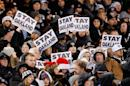 Oakland Raiders fans show 'Stay In Oakland' signs during the game against the San Diego Chargers on December 24, 2015 in Oakland, California